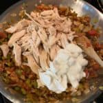 shredded rotisserie chicken and Greek yogurt on top of the vegetables and tomatoes