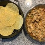 corn tortillas in a cast iron skillet before adding the chicken