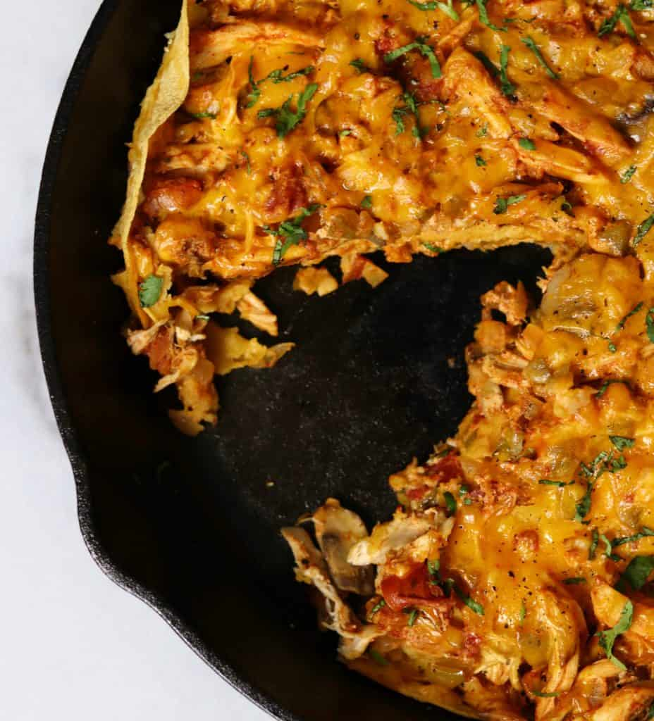 king ranch chicken casserole in a cast iron skillet