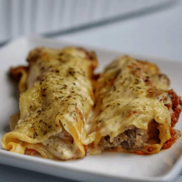 ricotta and beef cannelloni on a white plate