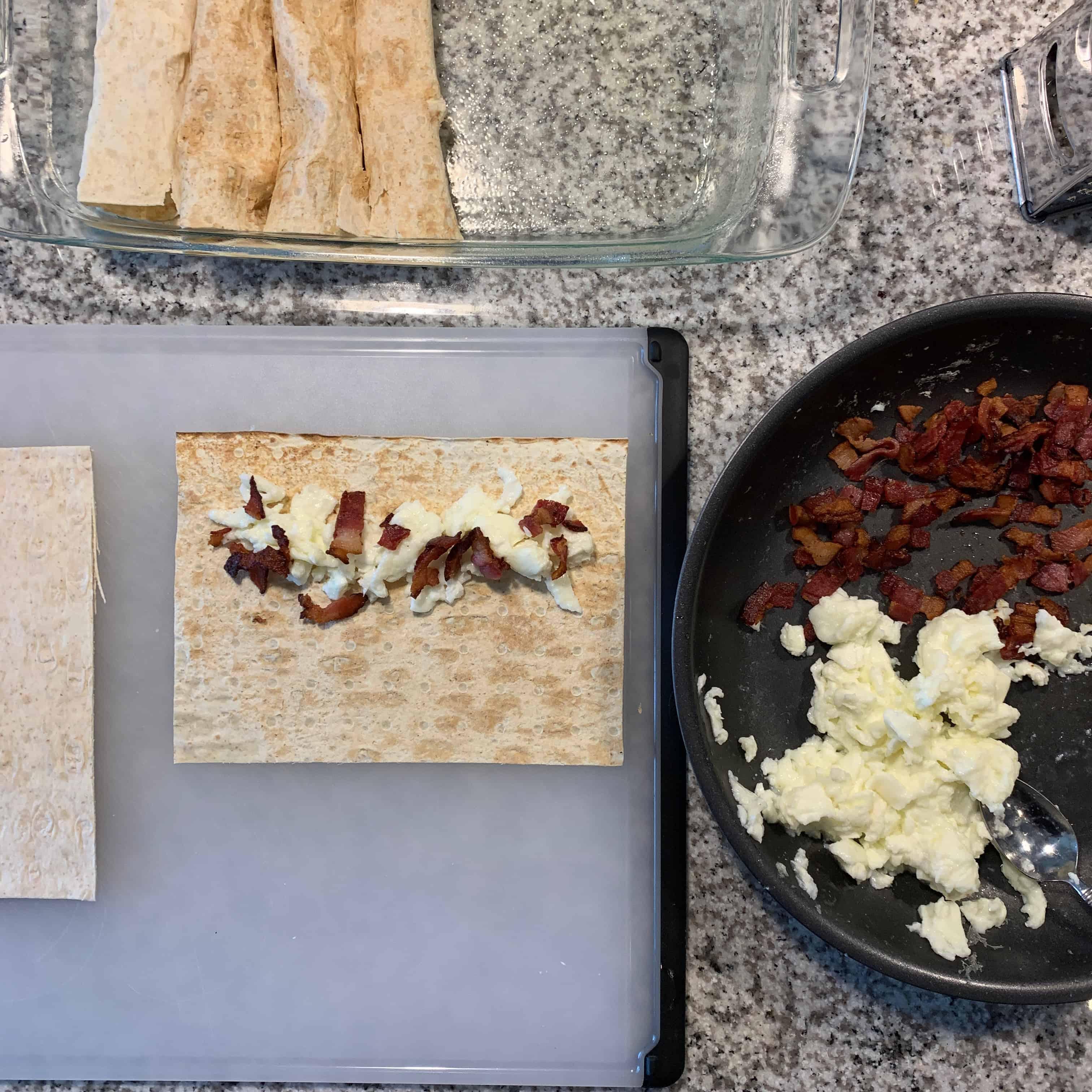 rolling breakfast enchiladas