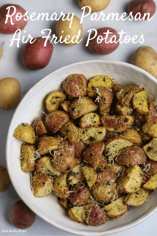 You'll love these air fried rosemary parmesan potatoes as a side with your next busy weeknight meal. They're crispy, take about 5 minutes to prep, and are much lower fat than traditionally fried potatoes. #airfryerrecipes #airfryer #potatoes #healthysides #airfriedpotatoes