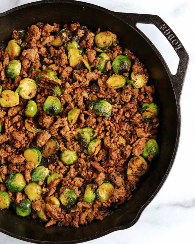 lodge cast iron skillet with ground beef and brussels sprouts