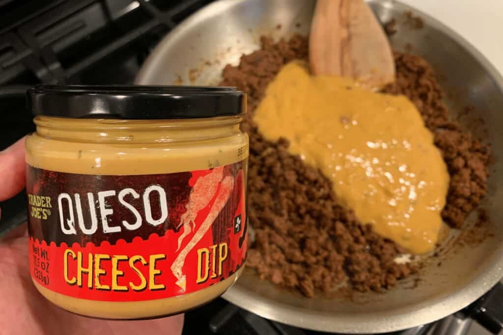 adding the Trader Joe's queso to the cooked ground beef