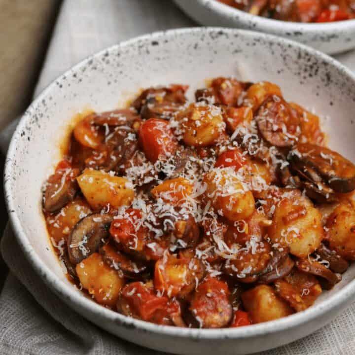 chicken sausage and mushroom cauliflower gnocchi in a stoneware bowl