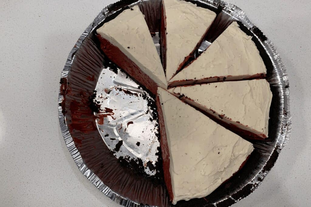 slices of cheesecake in the pie crust tin for freezing