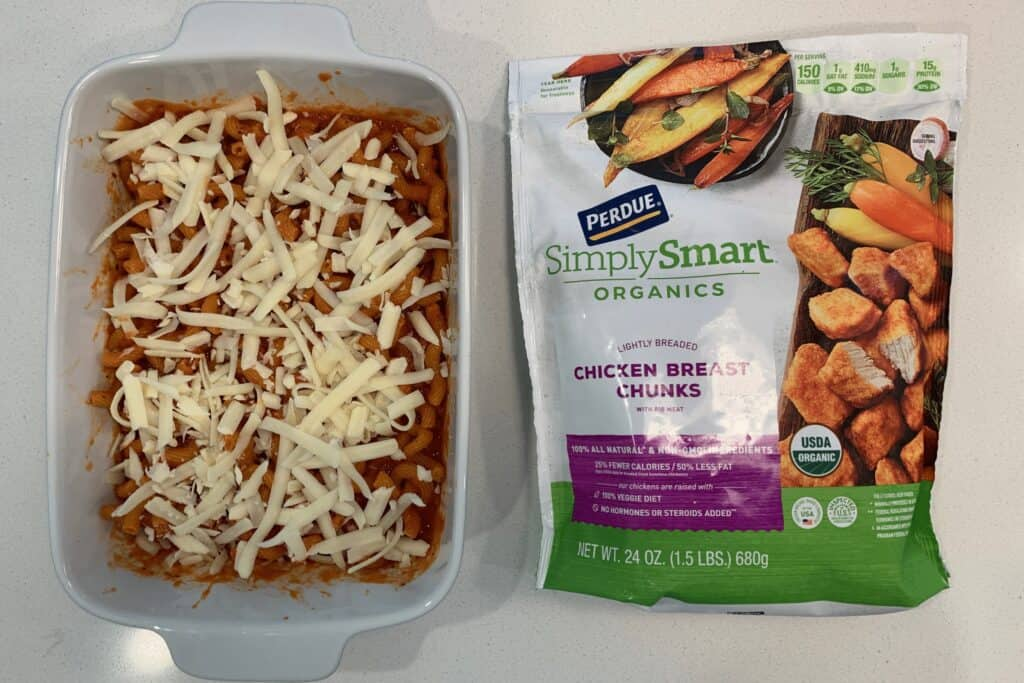 pasta and marinara topped with cheese next to Perdue Simply Smart lightly breaded chicken breast chunks