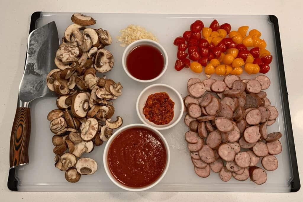 sliced mushrooms, cherry tomatoes, chicken sausage, minced garlic, marinara, chili pepper sauce, and red wine vinegar