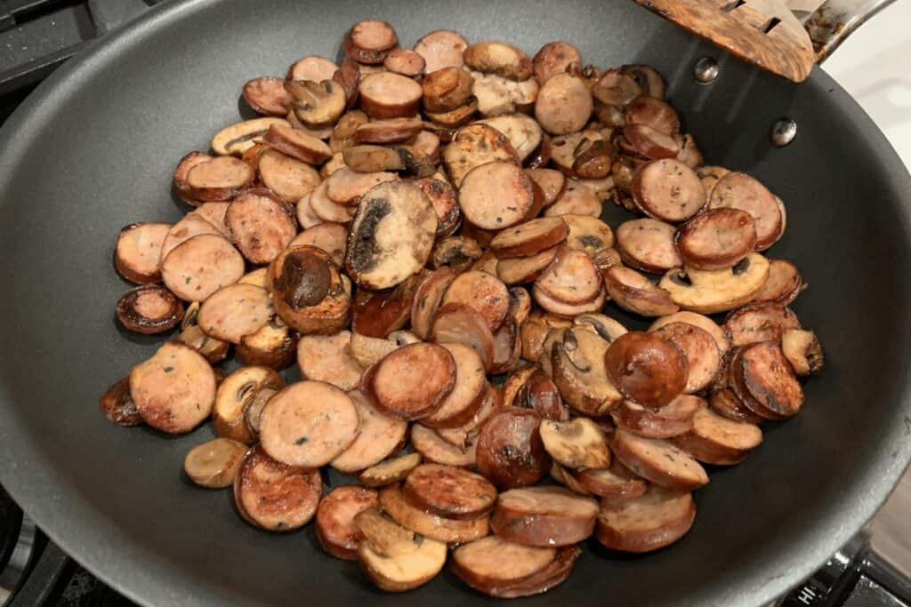 the sausage and mushroom slices in the pan after 5 minutes