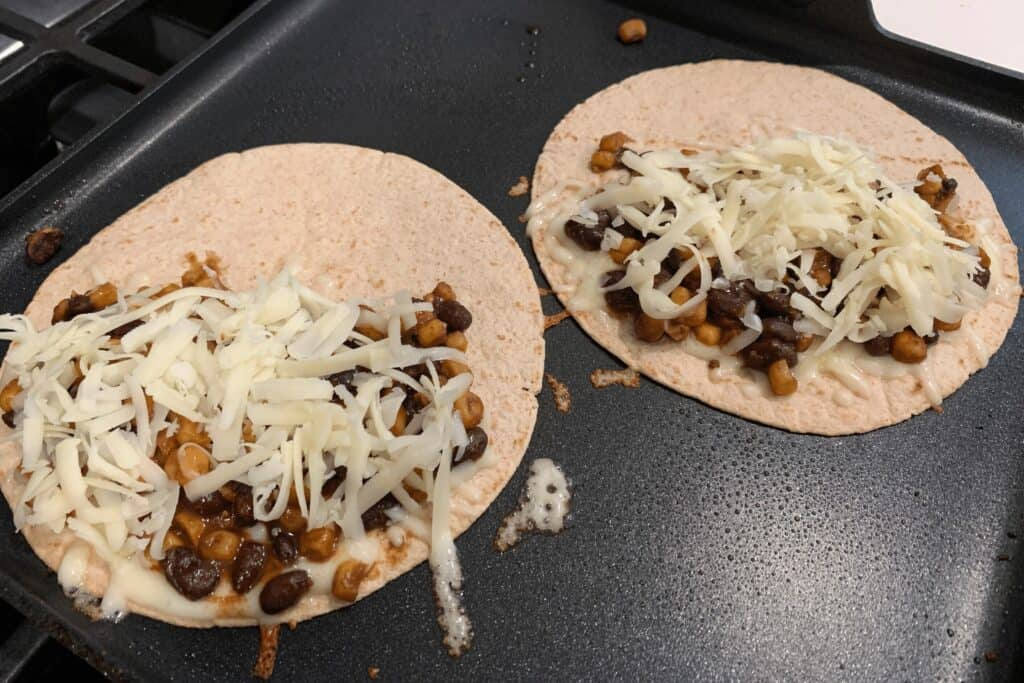making the black bean and corn quesadillas on a griddle