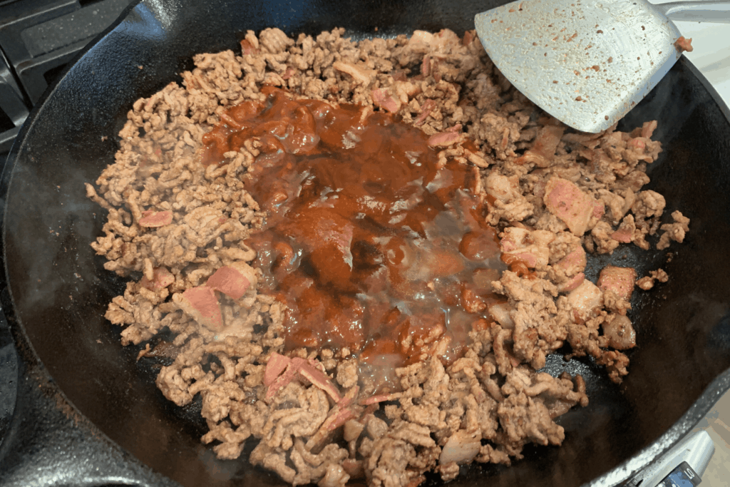 barbecue sauce, sriracha, and worcestershire sauce added to the cooked beef and bacon