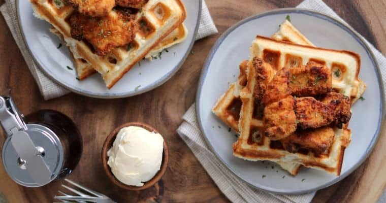 chicken and protein waffles on plates with butter and syrup
