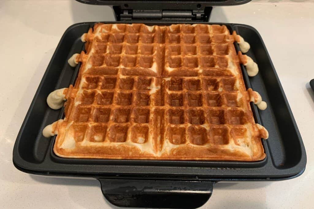 four protein waffles in a waffle maker