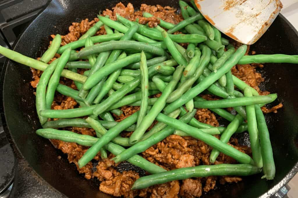 steamed green beans added to the ground beef and bacon