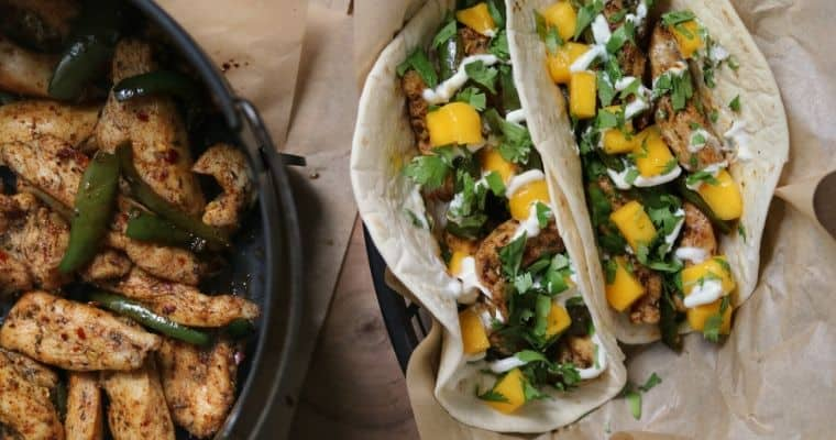 two Torchy's brushfire tacos next to an air fryer basket