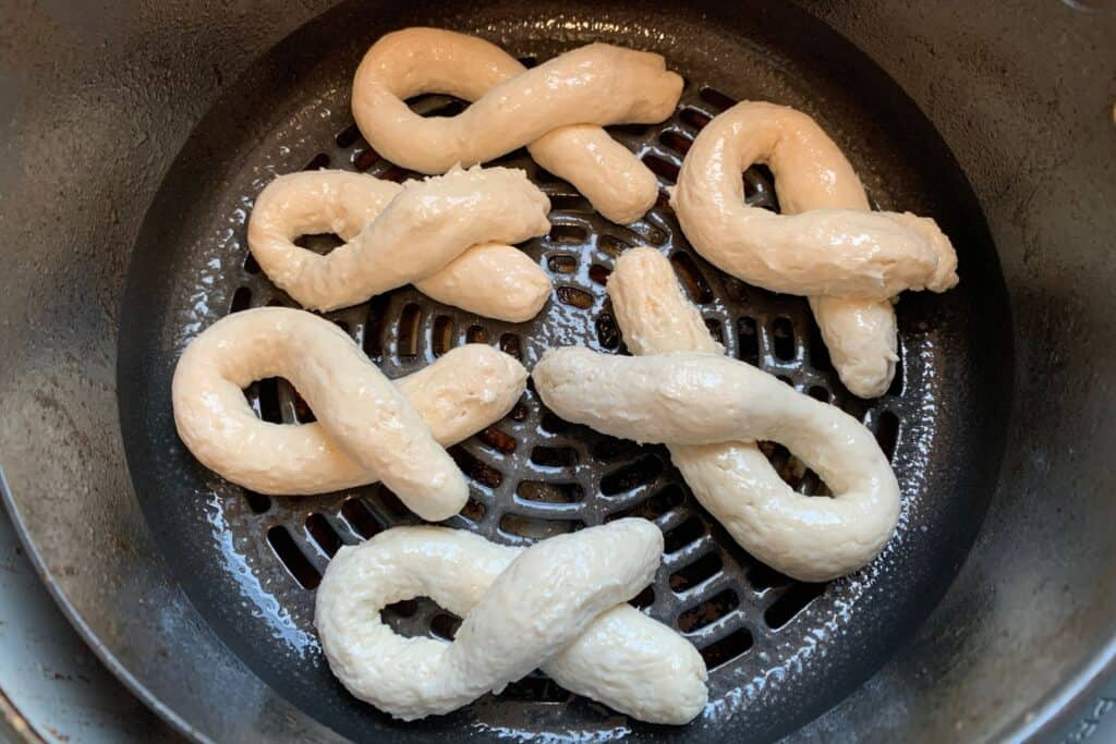 bread twists in the air fryer basket before cooking