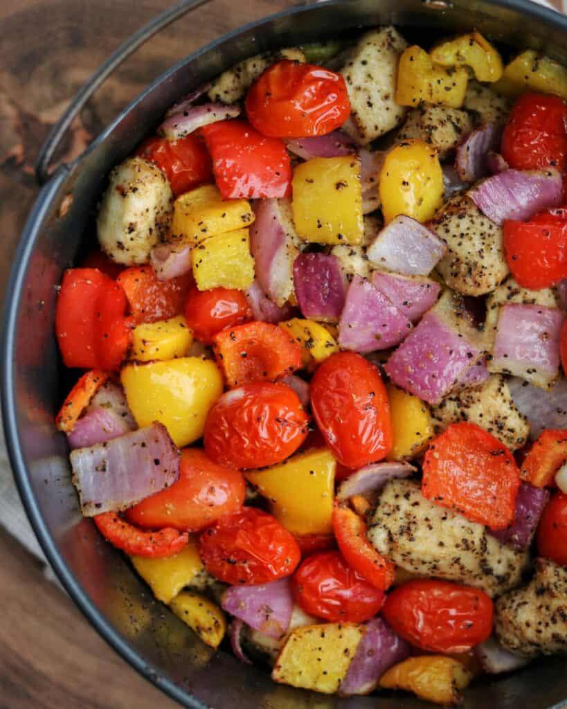 Greek chicken and veggies in the Ninja Foodi air fryer basket