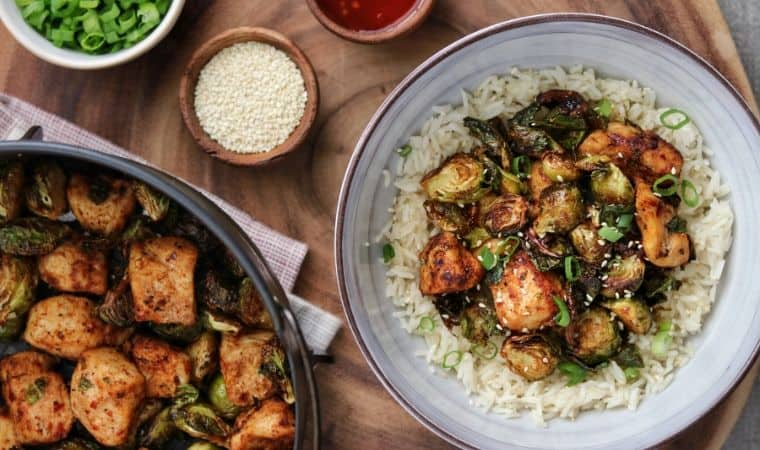 sweet chili chicken and brussels sprouts on a plate