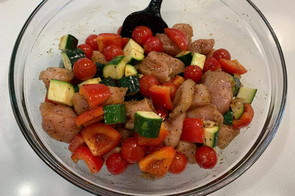 chicken breast, zucchini, bell pepper, and grape tomatoes with cajun seasoning and olive oil