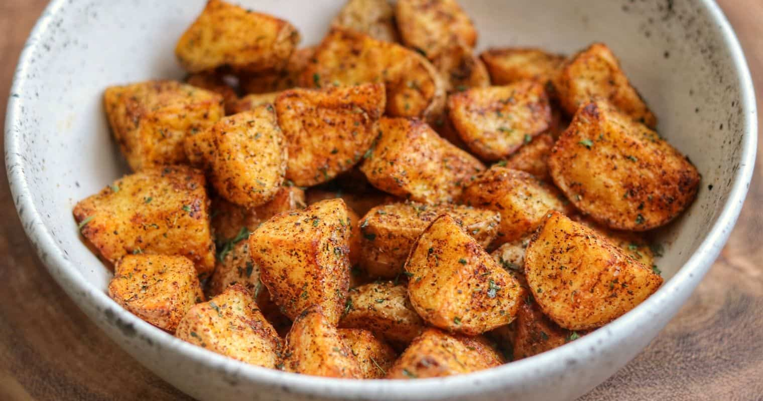 Mexican potatoes in a white bowl