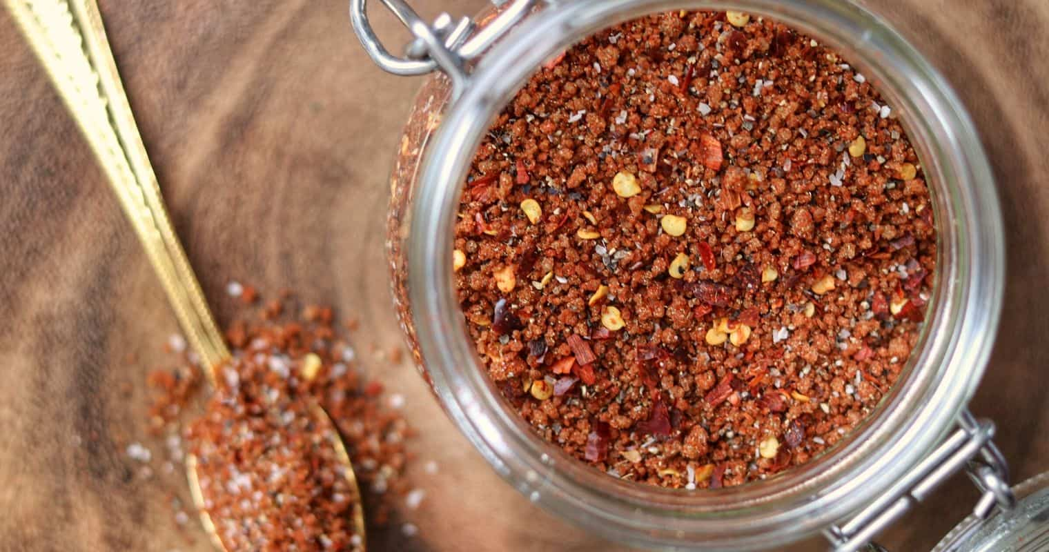 homemade breakfast sausage seasoning in a glass jar