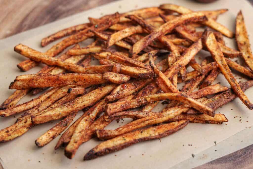 air fried copycat five guys cajun fries on parchment paper