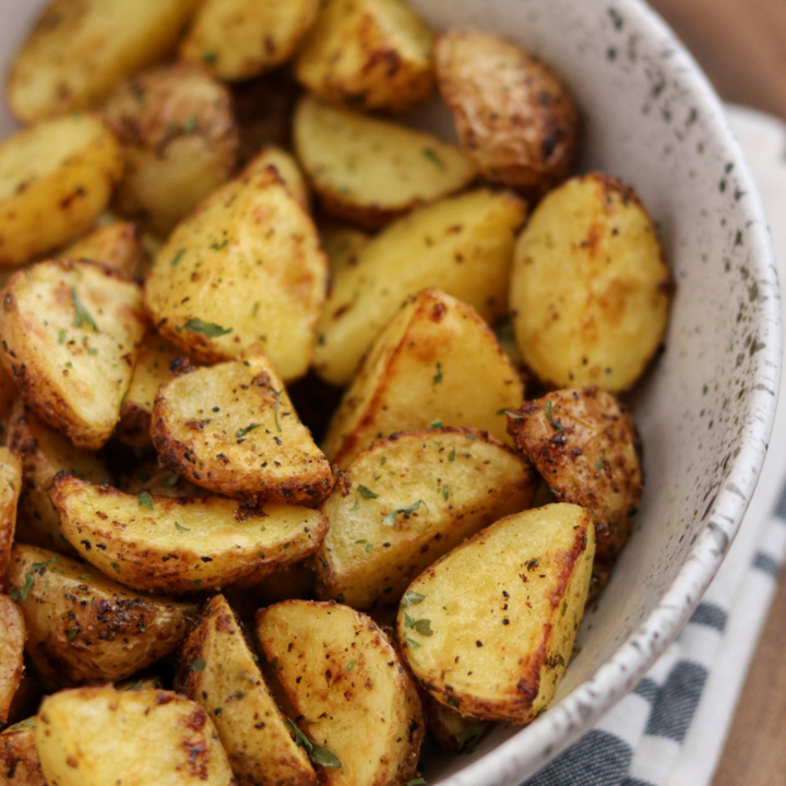 Greek potatoes in a white bowl