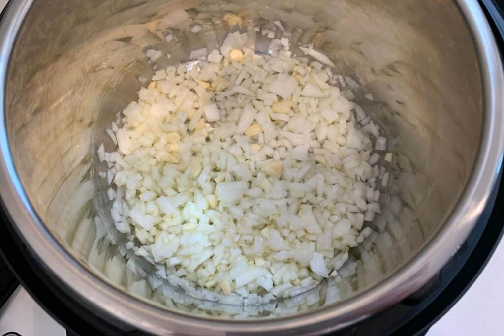 onion, garlic, and olive oil in the Instant Pot
