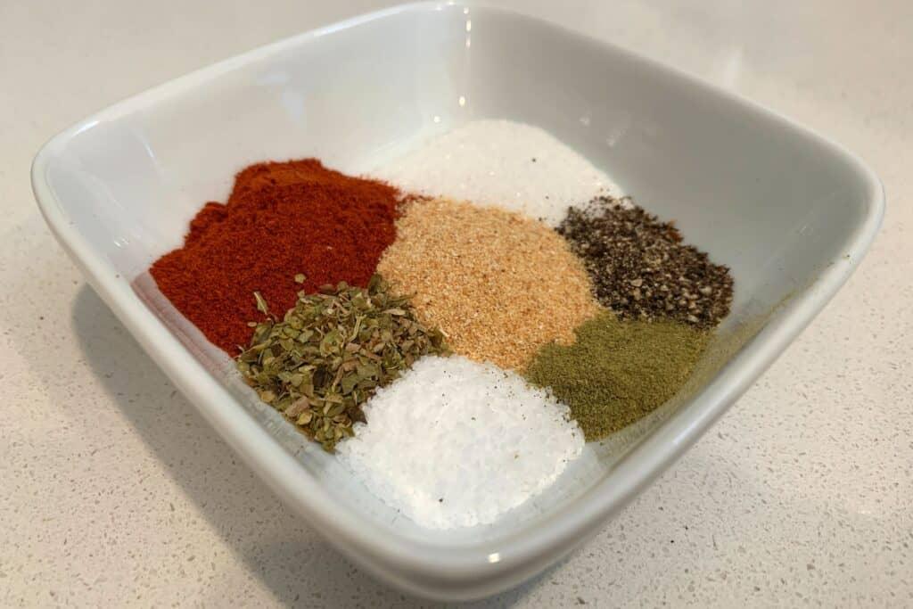 smoked paprika, sugar, salt, oregano, thyme, garlic powder, and black pepper in a bowl