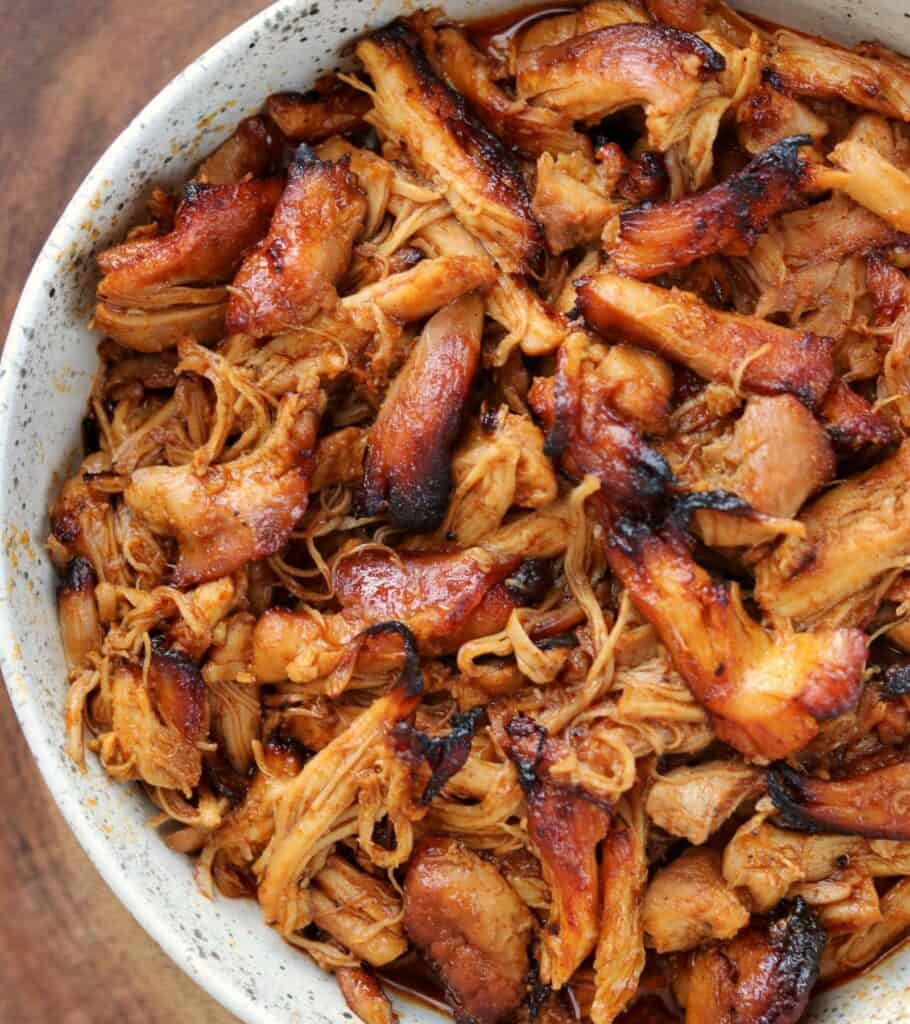 BBQ pulled chicken in a white bowl