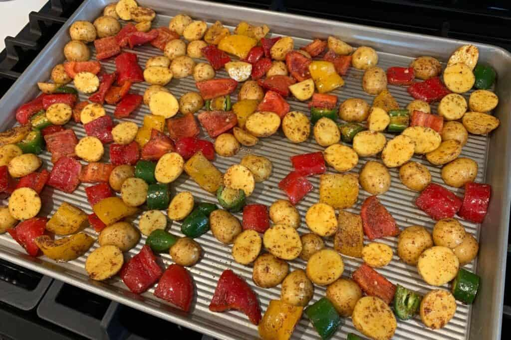 Mexican potatoes and peppers on a baking sheet