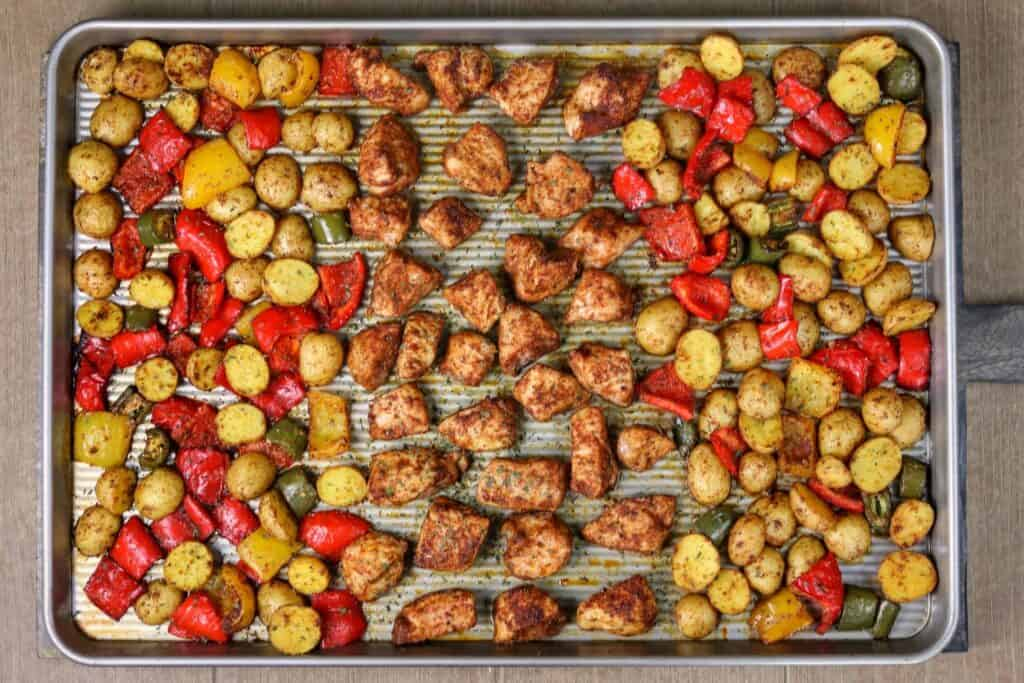 sheet pan with roasted chicken potatoes and peppers