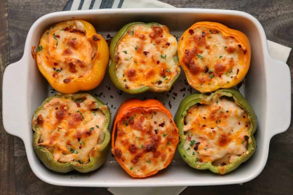6 buffalo chicken stuffed peppers in a baking dish