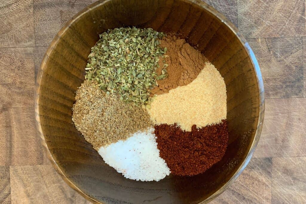 dried oregano, ground cinnamon, ground coriander, salt, chipotle chili powder, and garlic powder in a small bowl