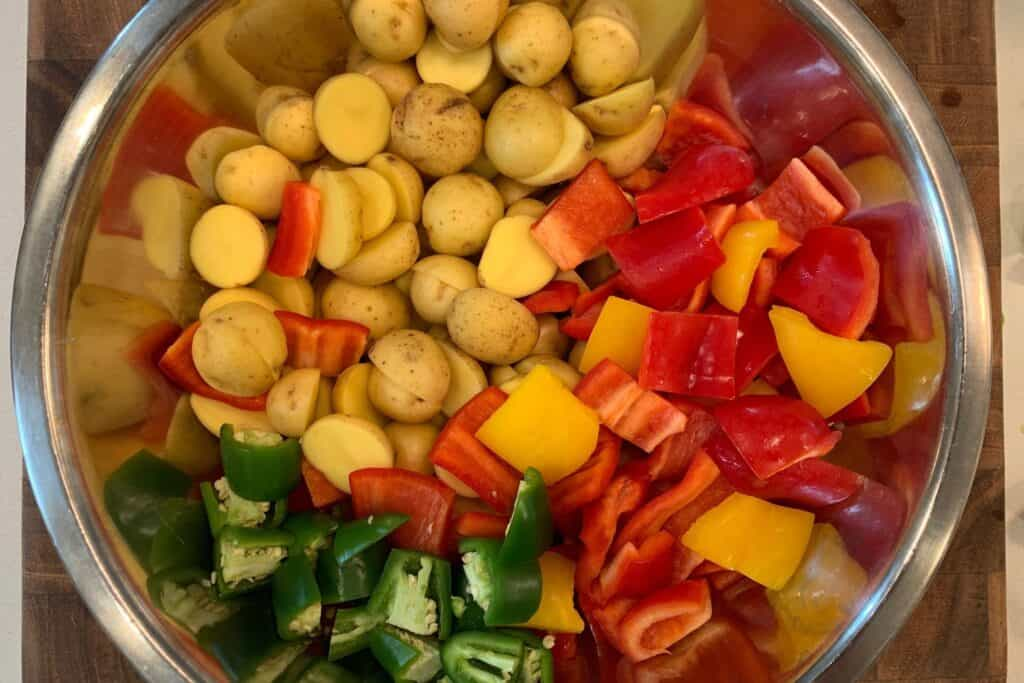 halved baby gold potatoes, diced bell pepper, and diced jalapeño peppers