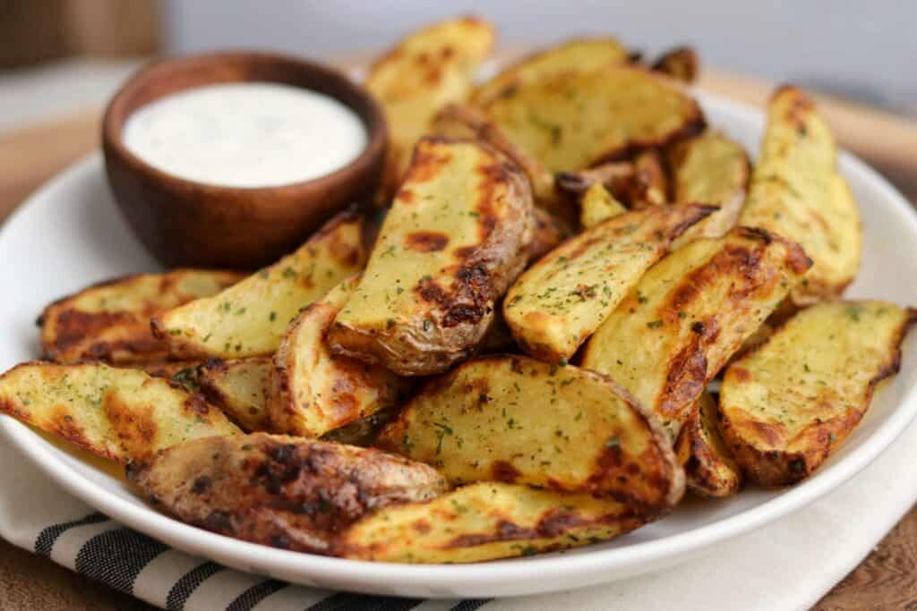 ranch potato wedges in a bowl with ranch dip