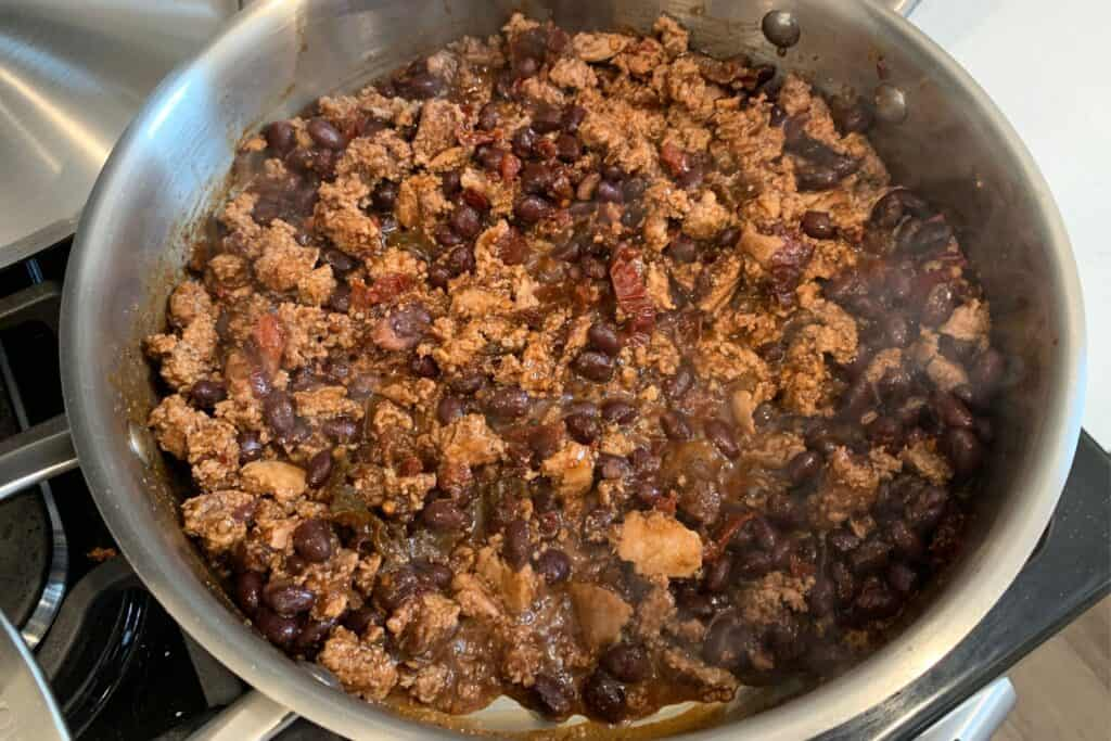 black beans, chipotle peppers, spices, and cooked ground turkey