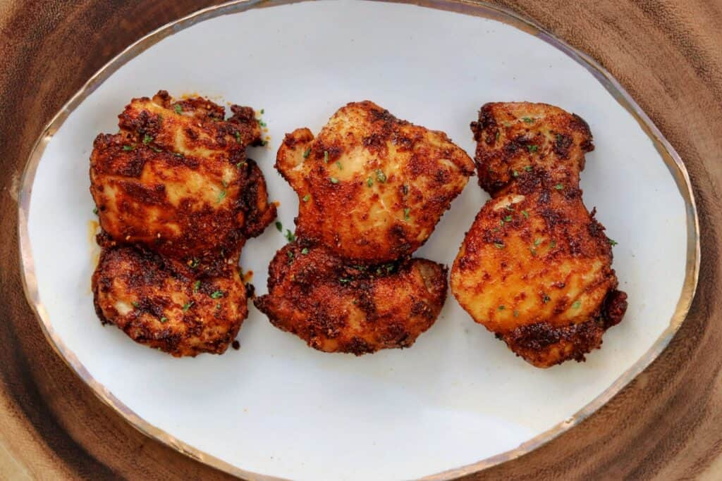 3 buffalo chicken thighs on a plate