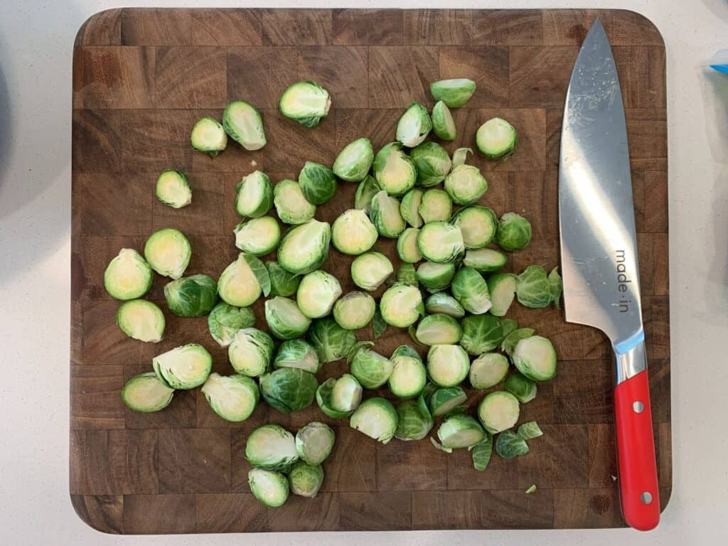 halved brussels sprouts on a cutting board