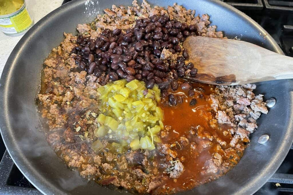 black beans, green chiles, and taco sauce added to the beef