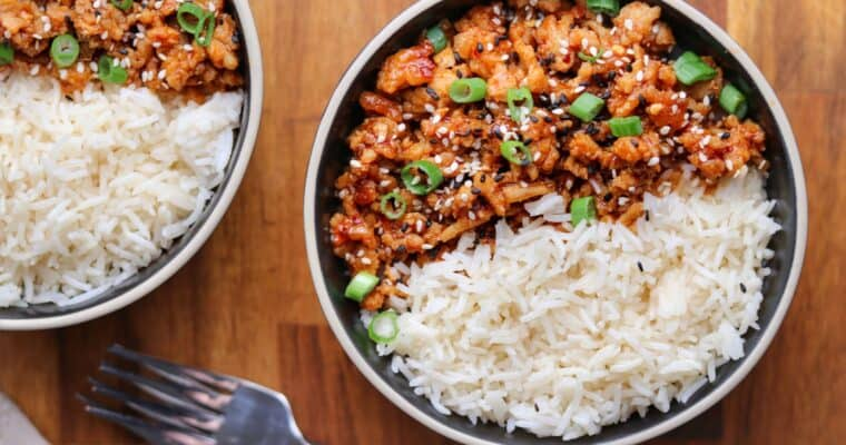 two bowls of firecracker ground chicken with rice