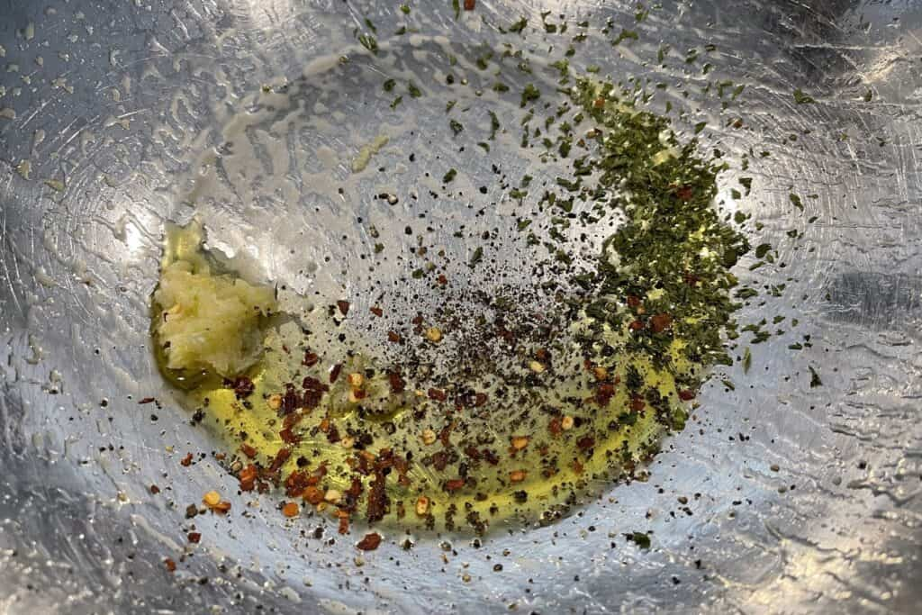 olive oil, crushed garlic, pepper, and parsley flakes