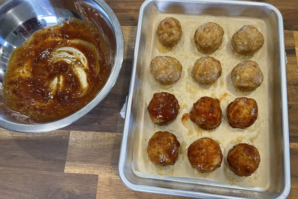 glazing the cooked chicken meatballs