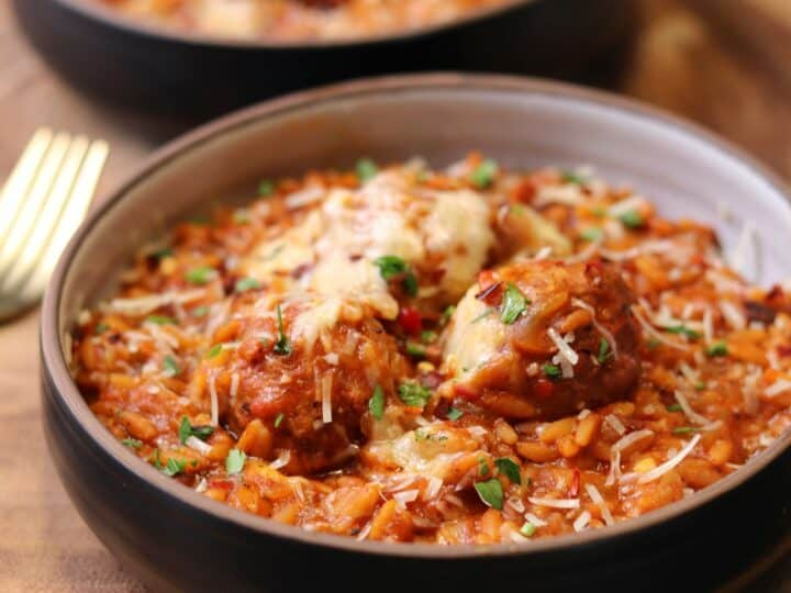 turkey meatballs and rice with melted cheese in a bowl