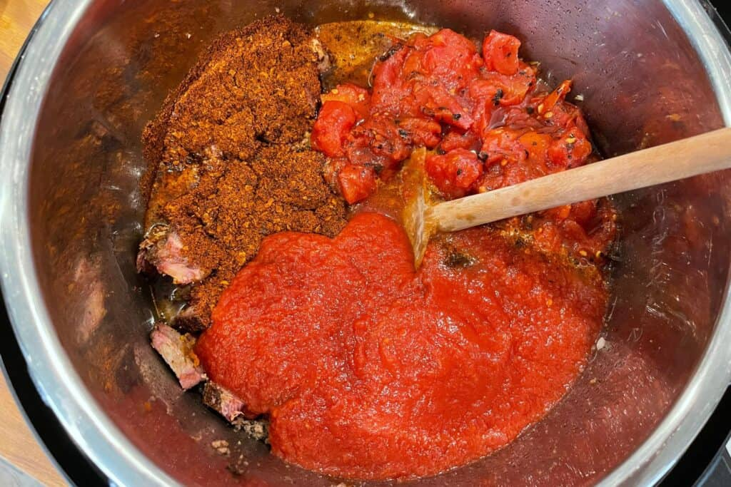 crushed tomatoes, fire roasted diced tomatoes, chili powder, and beer added to the chili