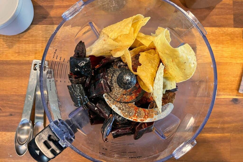 toasted chiles, tortilla chips, and dried spices for making homemade chili powder