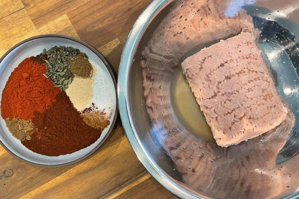 ground chicken and vinegar beside the bowl of a chorizo seasoning