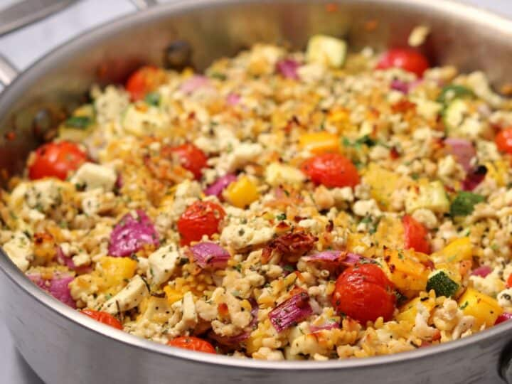 ground chicken, right rice, and vegetables in a sauté pan