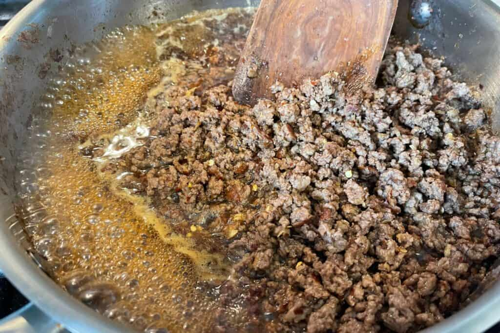 cooked lean ground beef with the Mongolian sauce in a sauté pan
