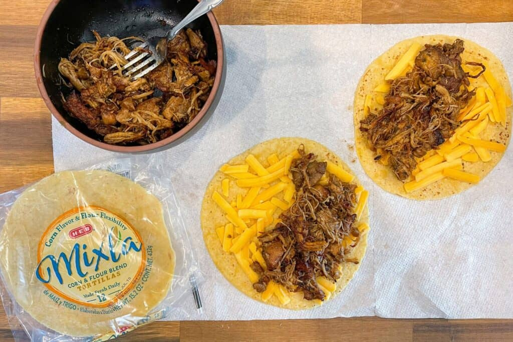 corn and flour tortillas with shredded cheese and chicken